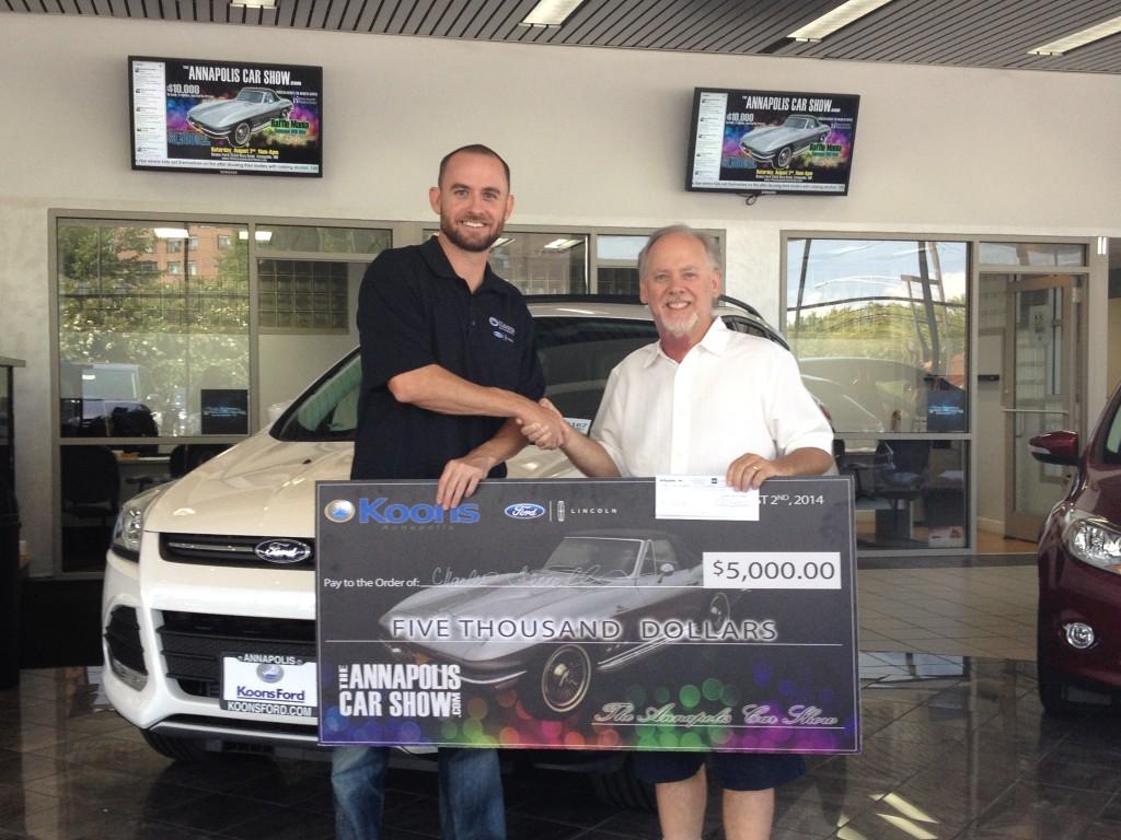 Joe Koons presents this years Raffle Mania winner, Mr. Charles Ferrell, his $5,000 Check!
